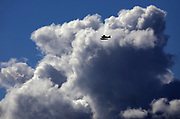 Viewed from Seattle's Magnolia area, a floatplane over Puget Sound is dwarfed by massive clouds. A sign of showers? (Ken Lambert/The Seattle Times)