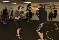 """Mike O'Neill and Don Clarke work on sparring drills during their """"Rock Steady Boxing"""" class at the Downtown Gym on Thursday evening.  (Karen Bobotas/for the Laconia Daily Sun)"""