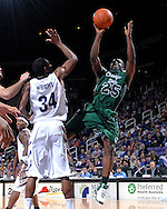 Chicago State Walter Woghiren (25) puts up a shot over Kansas State Akeem Wright (34), during the first half at Bramlage Coliseum in Manhattan, Kansas, January 22, 2007.  K-State leads the Cougars at halftime 38-17.