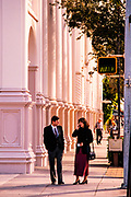 Business man and woman walk on Coral Gables Miracle Mile