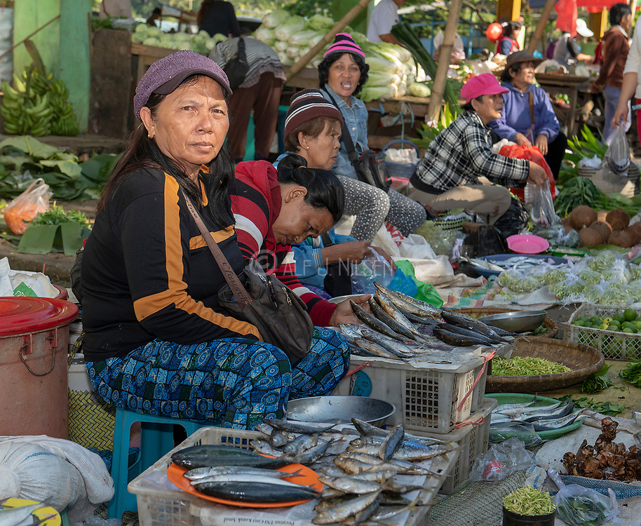 Selling fish and vegetables at Tomohon extreme market, north Sulawesi, Indonesia.