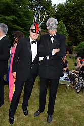 Left to right, MARIO TESTINO and HENRY WYNDHAM at The Animal Ball in aid of The Elephant Family held at Lancaster House, London on 9th July 2013.