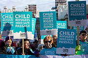 Supporters of the Child Refugee charity Safe Passage calling on Peers in the House of Lords to back an amendment and uphold refugee family reunion on the 20th of January 2020 in Parliament Square, Westminster, London, United Kingdom. 95% of the children currently receiving legal support from the charity Safe Passage International to reunite with relatives in the UK would not be eligible for family reunion under current UK Immigration Rules.