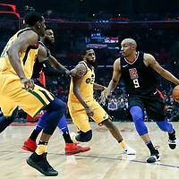 30 November 2017: LA Clippers guard C.J. Williams (9) drives past Utah Jazz forward Royce O'Neale (23) during the Utah Jazz 126-107 victory over the LA Clippers, at the Staples Center, Los Angeles, California, USA.