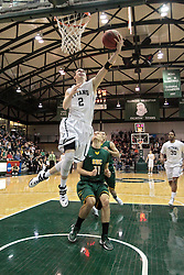 08 March 2014:  Dylan Overstreet completes a break away that started just past half court during an NCAA mens division 3 2nd Round Playoff basketball game between the St Norbert Green Knights and the Illinois Wesleyan Titans in Shirk Center, Bloomington IL