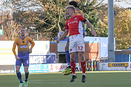George Lapslie of Charlton Athletic (32) beats Jacob Mellis of Mansfield Town (8) to a high ball during the The FA Cup match between Mansfield Town and Charlton Athletic at the One Call Stadium, Mansfield, England on 11 November 2018.