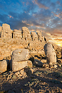 Statue heads at sunrise, from left, Eagle & Antiochus with headless seated statues in front of the stone pyramid 62 BC Royal Tomb of King Antiochus I Theos of Commagene, east Terrace, Mount Nemrut or Nemrud Dagi summit, near Adıyaman, Turkey