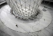 A man walks by the glass funnel-like structure of Sun Valley at the 2010 Expo site in Shanghai, China on 22 January 2010. Shanghai eventually spent some 40 billion usd in developing the expo site and related infrastructure, and saw a record breaking 70 million visitors, the site has seen limited use after the end of the expo.