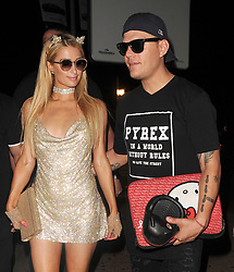 Paris Hilton arrives at Mirage nightclub in Puerto Banus at 4am, with boyfriend Chris Zylka, who was holding her headphones and laptop, which was in a Hello Kitty branded case. The couple were over two hours late, as Paris was due to arrive at 1.45am for a meet and greet, and then perform at 2.15am until 3.45am. But she ended up arriving AFTER she was originally due to finish, despite posting her entire schedule on social media for all to see. She gave no explanation to why she was late, and a large number of customers had already left before she turned up!<br /><br />13 August 2017.<br /><br />Please byline: Will/Craig/Vantagenews.com