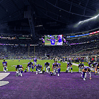 MINNEAPOLIS, MN - NOVEMBER 25: Players from the Minnesota Vikings pray in the end zone before the game against the Green Bay Packers at U.S. Bank Stadium on November 25, 2018 in Minneapolis, Minnesota. (Photo by Adam Bettcher/Getty Images)