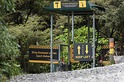 A Kauri Dieback forest entry footwear cleaning station at Tāwharanui Regional Park near Auckland. Boots should be scrubbed and rinsed with a solution, in order to prevent the spread of fungi and pathogens into forests where Kauri grow.