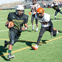 Skyhawks junior running back Deontay Begay (25), runs into the southern end zone, past several Mavericks defenders, for a Newcomb touchdown Saturday in Newcomb. Newcomb defeated Lordsburg 56-20.