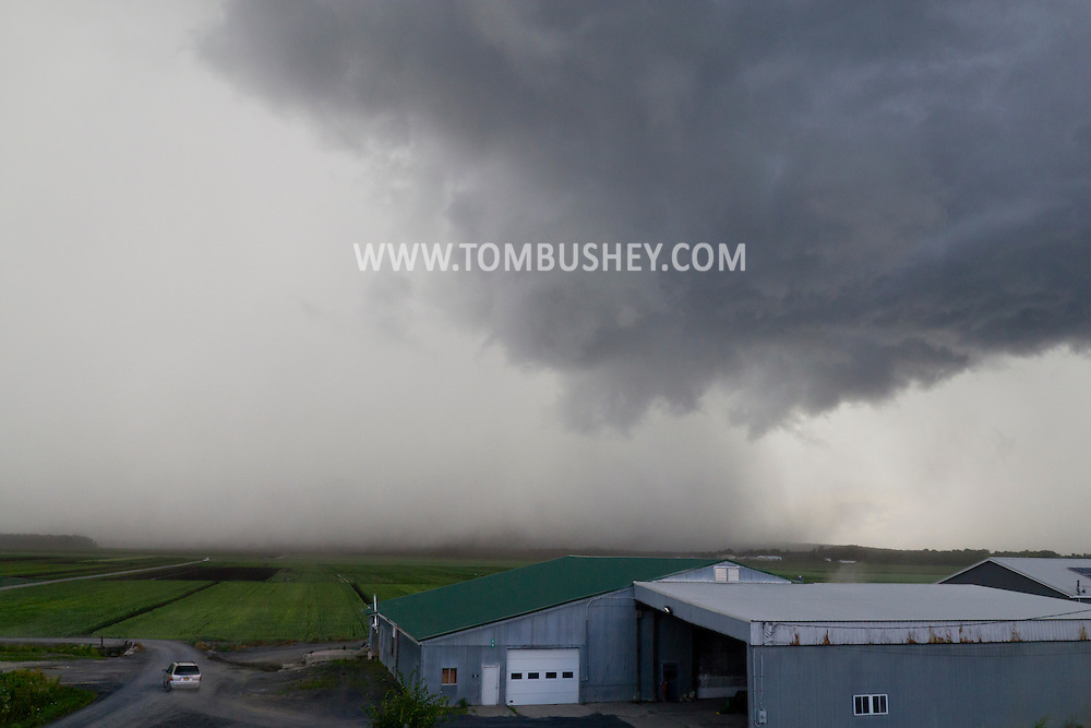 Goshen, New York - Winds from a summer thunderstorm carry dirt from farm fields through the air  on July 28, 2014. The brief storm brought high winds and heavy rain.