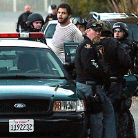 Maurice Ainsworth is taken into custody on English Drive in Santa Cruz, California on Monday November 29, 2010 after a 5-hour police manhunt. Ainsworth, who was being held in Santa Cruz County Jail, was being transported to Dominican Hospital for medical tests when he turned a Sheriff's deputy's taser on her and escaped. He was arrested without injuries.<br /> Photo by Shmuel Thaler <br /> shmuel_thaler@yahoo.com www.shmuelthaler.com