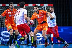 The Dutch handball player Samir Benghanem, Robin Schoenaker in action during the European Championship qualifying match against Turkey in the Topsport Center Almere.