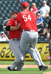 March 20, 2017 - Surprise, AZ, USA - Cincinnati Reds first baseman Joey Votto and starting pitcher Rookie Davis collide on an infield pop up for an out on Kansas City Royals' Whit Merrifield in the fourth inning on Monday, March 20, 2017 during a spring training baseball game in Surprise, Ariz. (Credit Image: © John Sleezer/TNS via ZUMA Wire)