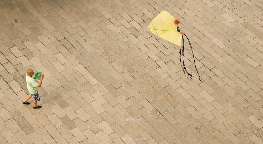 A man launches his kite in Xian, China