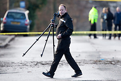 © Licensed to London News Pictures. 26/11/2017. Leeds, UK. Police forensic officers at the scene where a crash occurred involving a stolen car. Police say five people have been killed after a stolen car crashed into a tree on Saturday night. Two of the dead are 15 year old boys. The other is aged 12. Two fifteen year olds are in custody.  Photo credit: Andrew McCaren/LNP