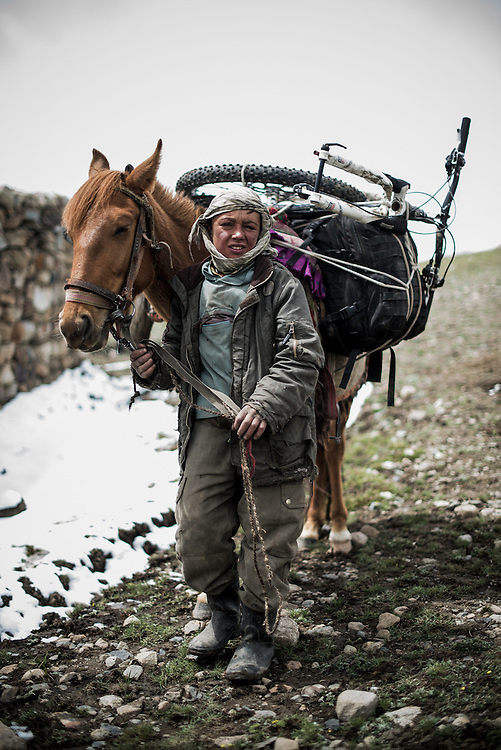 13 year old Askarkhan, at Karabel camp. I was told his name means 'soldier'. This was the only time we loaded bikes onto horses to make the climb easier for us.