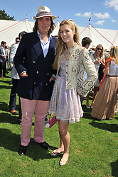 PATRICK LEIGH-PEMBERTON and ALLEGRA VAN ZUYLEN at the 27th annual Cartier International Polo Day featuring the 100th Coronation Cup between England and Brazil held at Guards Polo Club, Windsor Great Park, Berkshire on 24th July 2011.