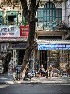 Sellers sit beside their shops filled with hardware products along Thuoc Bac street known for hardware goods in Hanoi's Old Quarter, Vietnam, Southeast Asia