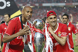 May 13, 2017 - Lisbon, Portugal - Benfica's defender Luisao (L) and forward Jonas hold the cup after winning their 36th title at the end of the Portuguese league football match SL Benfica vs Vitoria Guimaraes SC at the Luz stadium in Lisbon on May 13, 2017. (Credit Image: © Carlos Palma/NurPhoto via ZUMA Press)