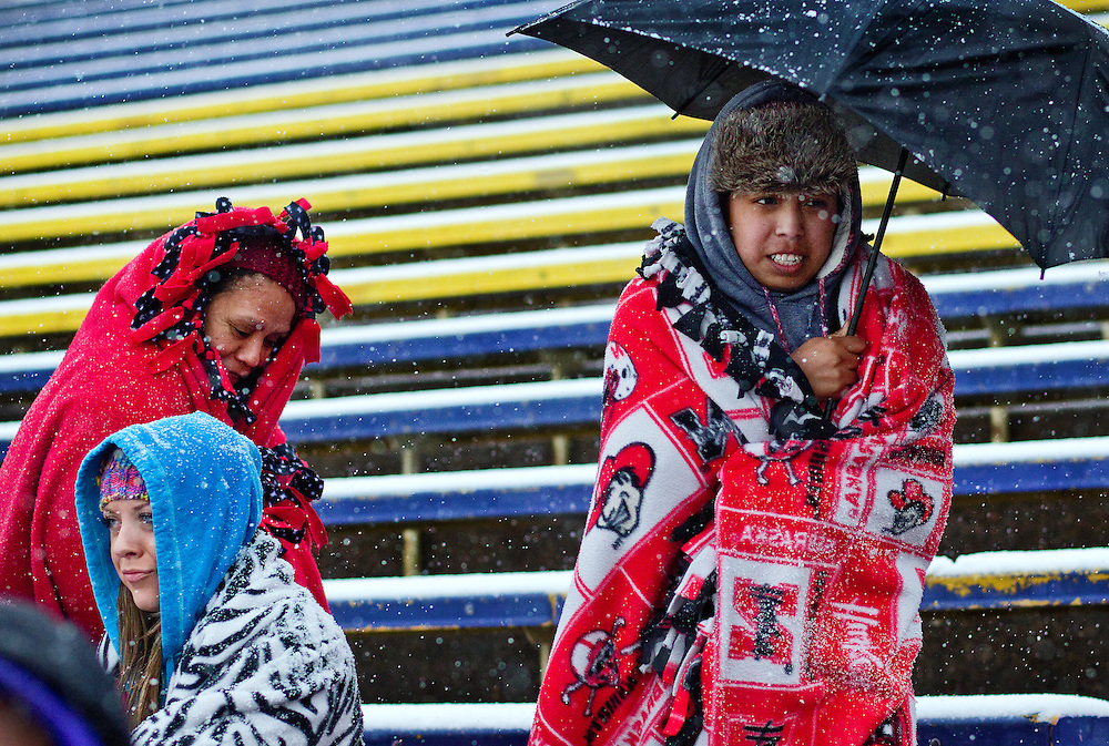 Fans bundled up but did not need to stay outside long as the Islanders' district soccer match against Lincoln North Star was canceled due to field conditions Wednesday at Grand Island Senior High. (Independent/Matt Dixon)