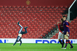 © Licensed to London News Pictures . 12/12/2016 . Manchester , UK . A pitch-invading youth does a cartwheel as MUFC players console each other at the final whistle . Manchester United vs Southampton FA Youth Cup Third Round match at Old Trafford . Photo credit : Joel Goodman/LNP