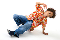 Little boy doing gymnastics in the studio,
