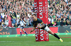 04/10/2014. Francois Hougaard of the Springboks smilers as he dives over the line  to score the first try of the day against the All Blacks players during the test match held at Ellis Park Stadium. <br /> <br /> Picture: Masi Losi