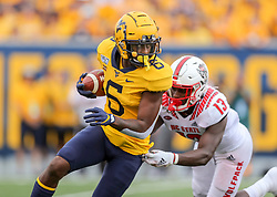 Sep 14, 2019; Morgantown, WV, USA; West Virginia Mountaineers running back Kennedy McKoy (6) runs the ball during the first quarter against the North Carolina State Wolfpack at Mountaineer Field at Milan Puskar Stadium. Mandatory Credit: Ben Queen-USA TODAY Sports