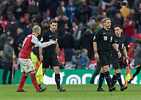 Football - 2018 Carabao (EFL/League) Cup Final - Manchester City vs. Arsenal<br /> <br /> Jack Wilshere (Arsenal FC) appreals to referee Craig Pawson as they walk off at half time having been fouled throughout the game at Wembley.<br /> <br /> COLORSPORT/DANIEL BEARHAM