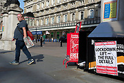 At Charing Cross station, London's Evening Standard newspaper headlines with news about Covid lockdown rules on the day that UK Prime Minster, Boris Johnson announced in parliament a major easing of Coronavirus pandemic restrictions on July 4th next week, including the re-opening of pubs, restaurants, hotels and hairdressers in England, on 23rd June 2020, in London, England. The three month two metre social distance will be also reduced to one metre plus but in the last 24hrs, a further 171 have died from Covid, bringing the UK total to 42,927.