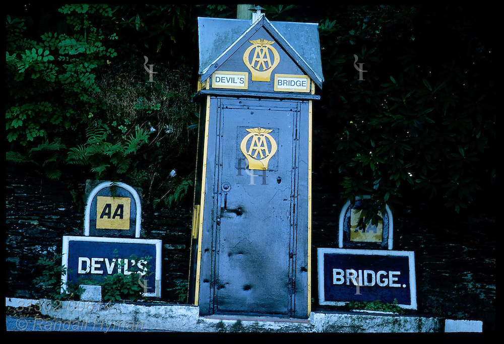 Road marker sponsored by Britain's Automobile Association (AA) at Devil's Bridge; mid Wales.