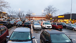 © Licensed to London News Pictures. 21/12/2020. London, UK. Car park full in Sainsbury's supermarket in north London before 8am as shoppers buy festive groceries, just four days before Christmas day amid a French ban on British hauliers. France closed its border to UK travellers from 11pm last night as London, the South East of England and many parts of the UK went into Tier 4 lockdown as a new variant of the COVID19 virus continues to spread. Photo credit: Dinendra Haria/LNP