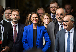 © Licensed to London News Pictures. 24/09/2019. London, UK. Businesswoman GINA MILLER is seen smiling while leaving The Supreme Court in London with her lawyer LORD DAVID PANNICK QC (right) following a ruling on an appeal against a judicial review of Boris Johnson's suspension of Parliament. The case has been brought by remain campaigner Gina Miller, with support from former British Prime Minister John Major. Photo credit: Ben Cawthra/LNP