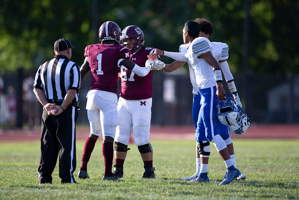 Captains fist bump after the coin toss prior to the Marian-Mishawaka high school football game on Friday, August 21, 2020, at Steele Stadium in Mishawaka, Indiana.