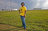 Sharon Lavinge founder of RISE St. James in font of oil storage tanks in St. James Parish.