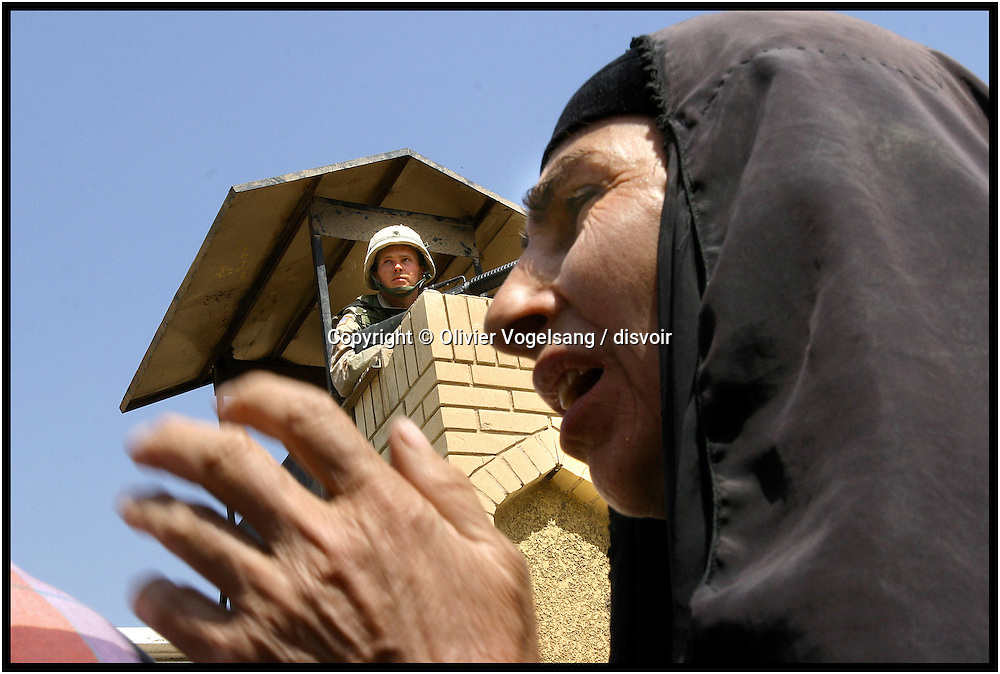 Iraq. Baghdad. A woman is waiting for news of relatives in front of a jail. Many people disapeared during the regime of Saddam Hussein and believe they are still alive undergroud.