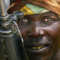 A herdsman from the  Kenyan Pastorlist tribe Takana watches the peace talks between his tribe and the Merile tribe from Ethiopia, one mile from the Ethiopian Border in Todonganya Kenya.PhotographDavid Cheskin.Press Association.