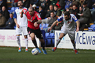 Oldham Athletic's Gary Harkins (c) gets away from Tranmere Rovers' Danny Holmes. Skybet football league 1match, Tranmere Rovers v Oldham Athletic at Prenton Park in Birkenhead, England on Saturday 1st March 2014.<br /> pic by Chris Stading, Andrew Orchard sports photography.
