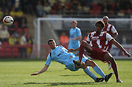 Shamir Goodwin of Torquay is fouled by Sido Jombati of Cheltenham (r). Skybet football league two match, Cheltenham Town v Torquay Utd at the Abbey Business stadium, Whaddon Rd in Cheltenham on Saturday 15th March 2014.<br /> pic by Mark Hawkins, Andrew Orchard sports photography.