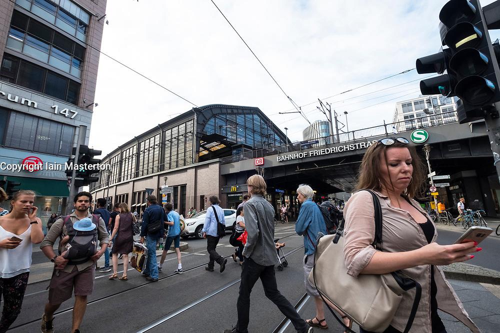 Street scene at pedestrian crossing beside Friedrichstrasse railway station in Berlin, Germany