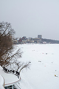 View of frozen Lake Mendota from the Edgewater Hotel on a cold winter day. Madison, Wisconsin, USA.