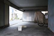indoor ground floor parking garage with for rent sign Japan Yokosuka