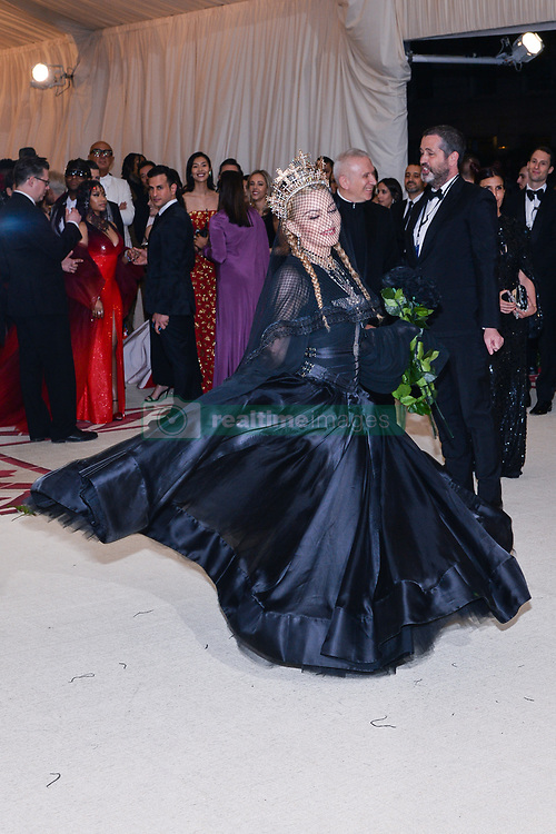 Madonna walking the red carpet at The Metropolitan Museum of Art Costume Institute Benefit celebrating the opening of Heavenly Bodies : Fashion and the Catholic Imagination held at The Metropolitan Museum of Art  in New York, NY, on May 7, 2018. (Photo by Anthony Behar/Sipa USA)
