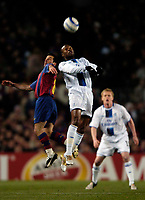 Photo. Jed Wee.<br /> FC Barcelona v Chelsea, UEFA Champions League, 23/02/2005.<br /> Chelsea's William Gallas beats Barcelona's Ludovic Giuly to the ball as Damien Duff looks on.