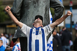 © Licensed to London News Pictures. 30/05/2017. Huddersfield, UK. Huddersfield Town's owner, players, staff and fans all celebrate in Huddersfield town centre after successfully gaining promotion to the Premier League for the first time yesterday. Underdogs Huddersfield beat Reading on penalties at Wembley yesterday to take their place in the Premier League ending a 45 year absence from the top flight of English football. Photo credit : Ian Hinchliffe/LNP
