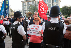 © Licensed to London News Pictures.20/04/2016. Bristol, UK.  Protest outside an auction of council houses held at All Saints Church in Pembroke Road, Clifton, Bristol. Campaigners want the council to stop selling off 14 council homes on 20 April by auction to the private sector. Bristol City Council says the homes are expensive to repair, but some campaigners question whether the costs of repairs are inflated, and also whether the homes will be bought and then relet to the Council for temporary accommodation at higher than normal rents.  A group of residents of St. Paul's and the Inner City are campaigning against the sale. They are working in partnership with The Community Rights Project, The Bristol People's Assembly, and members of the ACORN community union. Photo credit : Simon Chapman/LNP