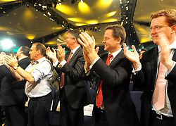 © Licensed to London News Pictures. 20/09/2011. BIRMINGHAM, UK.   Danny Alexander (r ) and Nick Clegg (red tie) applaud Chris Huhne (not pictured) after he delivers his speech on the climate at the Liberal Democrat Conference at the Birmingham ICC today (20 Sept 2011): Stephen Simpson/LNP . Photo credit : Stephen Simpson/LNP